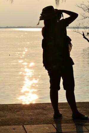 hobbyist: A traveller taking a photo sunset,Don Hoi Lot,Samut Songkhram Province,Thailand