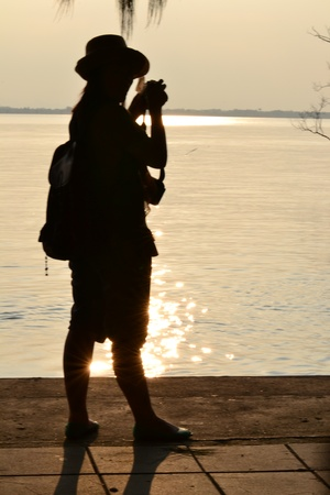 A traveller taking a photo sunset,Don Hoi Lot,Samut Songkhram Province,Thailand