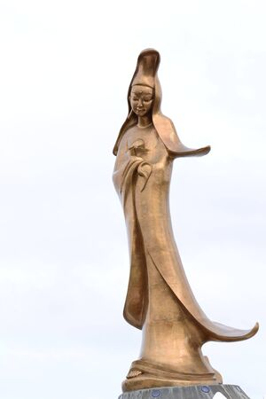 Guan Yin statue on white background,macau,Asia photo