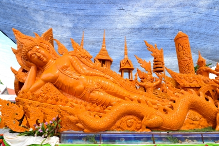 Candle Carving Tradition , for worship the Buddha on the occasion of Visakha Bucha Day in Suphan Buri,Thailand. photo