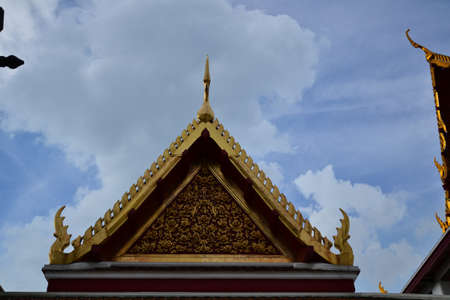 Thai temple with blue sky background ( Ratchanaddaram Temple) ,Bangkok, Thailand. photo