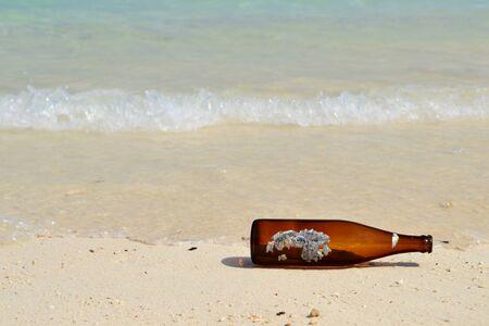 Bottle on beach Stock Photo - 16762563