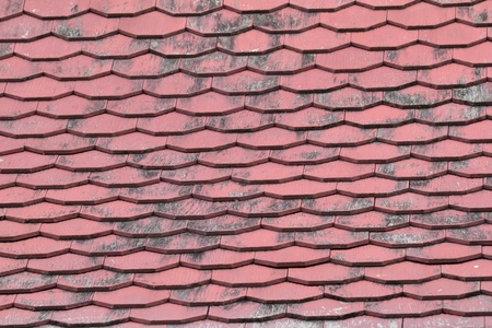 Old roof of a house made of wooden tiles photo