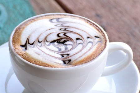 cappuccino: Cup of coffee with artistic cream decoration