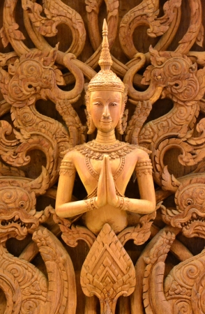 An ancient mural wood carving in Thai temple. photo