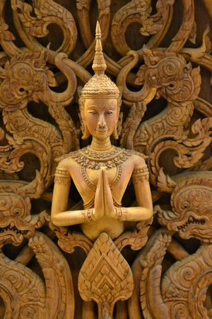 An ancient mural wood carving in Thai temple. Stock Photo - 18223792