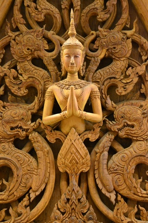 An ancient mural wood carving in Thai temple. Stock Photo - 18223796