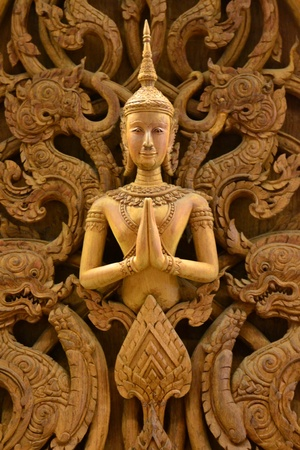 An ancient mural wood carving in Thai temple. Stock Photo - 18223779