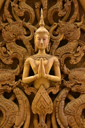 An ancient mural wood carving in Thai temple.
