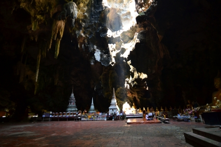 Buddha statue and Natural light inside the cave at Khaoluang, Phetchaburi Province, Thailand. Stock Photo - 18566757