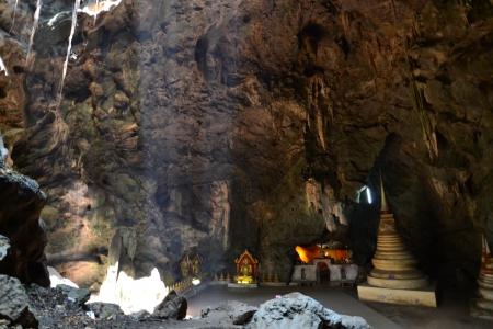 Buddha statue and Natural light inside the cave at Khaoluang, Phetchaburi Province, Thailand. Stock Photo - 18566405