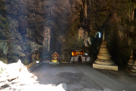 Buddha statue and Natural light inside the cave at Khaoluang, Phetchaburi Province, Thailand. Stock Photo - 18566319
