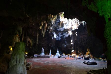 Buddha statue and Natural light inside the cave at Khaoluang, Phetchaburi Province, Thailand. Stock Photo - 18566592