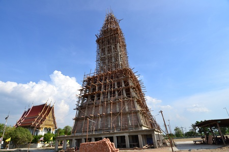 Unfinished building with blue sky background,Thailand. photo