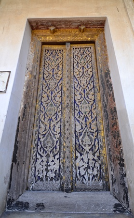 Old Thai temple door inThai temple,Saraburi province,Thailand. Stock Photo - 19737802