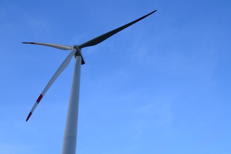 Electric wind turbine generator on blue sky,Thailand. photo