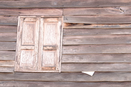 Old wooden textured wall and window  from Thailand. photo