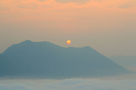 Fog and sunrise on the top  of Phutog Moutain,Chiang Khan,Thailand. photo