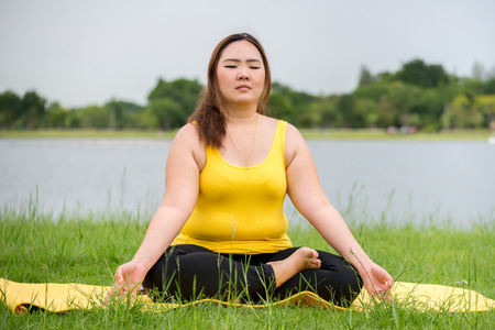 yoga meditation: Fat woman was meditating