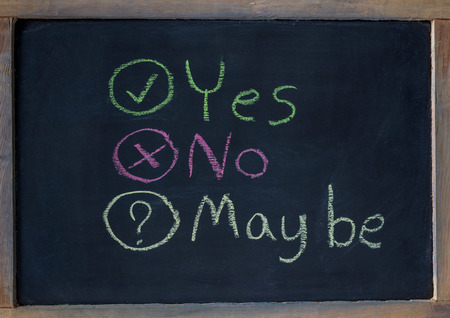 maybe: Drawing - Choose Yes No Maybe on black chalkboard