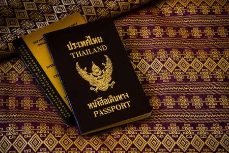 thai silk: thai old passport on thai silk purple-gold