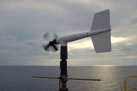 Anemometer fan is moving in the cloudy sky background.