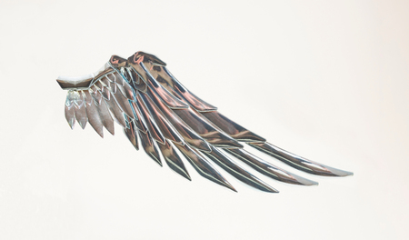 Metallic silver angel wing.Freedom fairy symbol.Isolated on white background Stock Photo