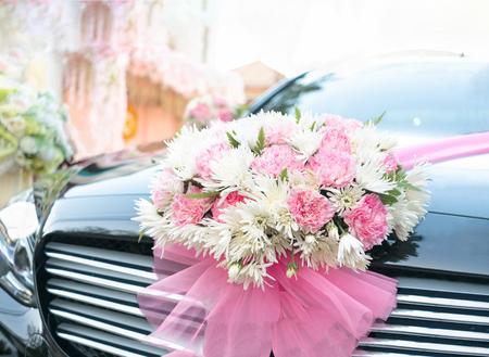 Wedding bouquet flowers on luxury black car