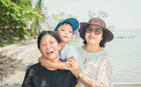 the grand daughter: Warm family enjoy on vacation at Andaman sea Thailand Stock Photo