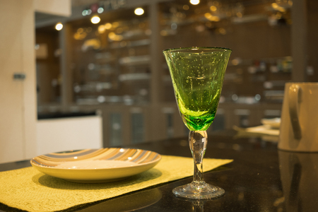 Personal meal. Close up beautiful green glass with colorful plate. Greeting concept Imagens