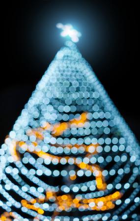 Shining star Christmas tree and bokeh light on night