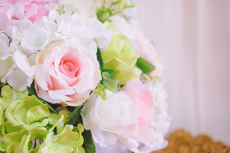 Bouquet of artificial flowers on ceremony day