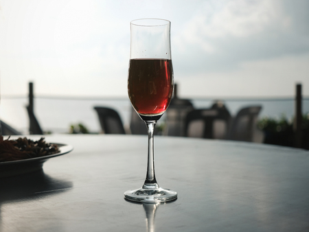 Red wine glass with beautiful sea view in Phuket Thailand