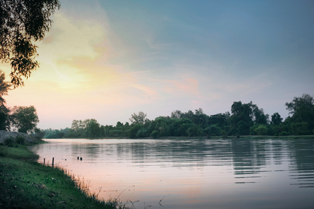 Tranquil river with sunrise scene connect to lake in Songkhla Thailand