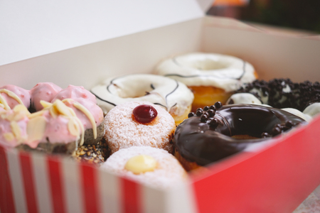 Assorted various of donuts with cream and powder glazed