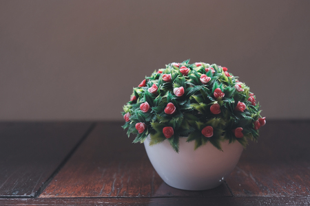 Beautiful artificial flowers pot with morning light