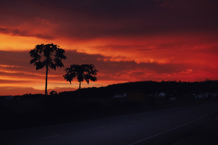 Sunset scene dramatic sky and spin cloud with countryside street Imagens