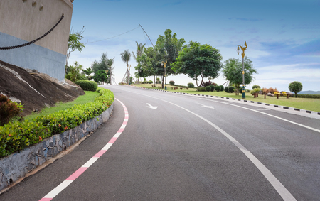 Perspective view of road with public park scenery in Chumphon Thailand
