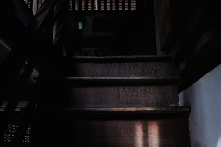 Old wooden stair in ancient house. Selective focus