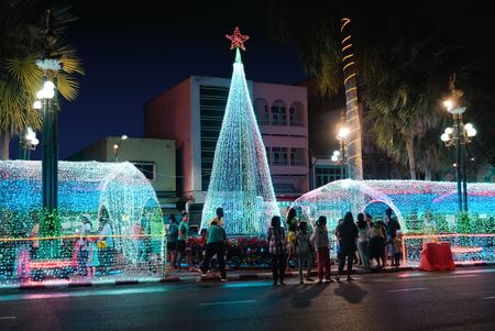 Trang,Thailand - December 26, 2018 : People enjoy visited at christmas building and new year's eve festival in traffic island near the clock tower