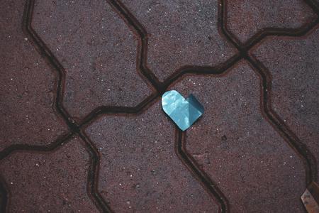 Fallen blue crumpled heart on valentine day Imagens