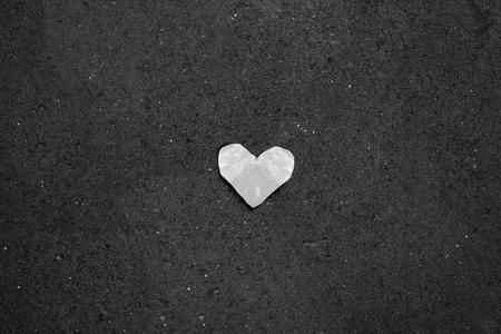 Fallen crumpled heart on rough floor