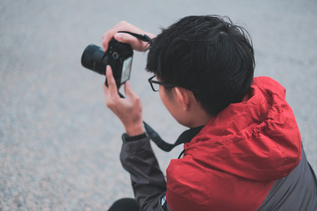 Young photographer take photos on street
