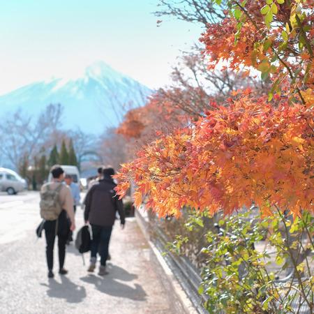 Autumn season in Japan with tourist men heading to Fuji mountain