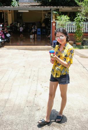 Thai girl holding water gun on Songkran's day Imagens - 123871542