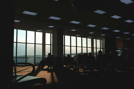 Silhouette passenger room at the airport background Imagens