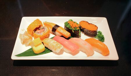 Set of assorted sushi, japanese food in restaurant ready to eat Imagens - 127788337