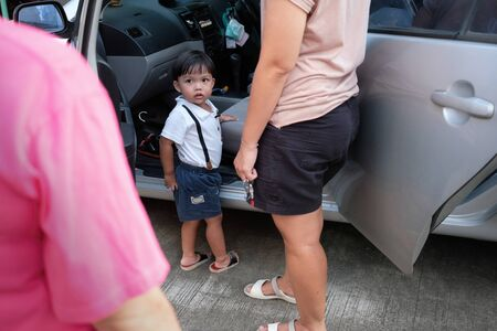 Parent sent kid on the car to travel on trip and little student go to school. Separation concept