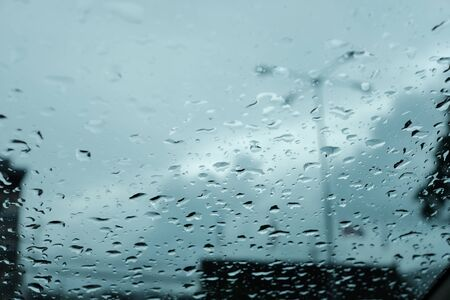 Low angle view of raindrop on windshield glass with evening sky Imagens