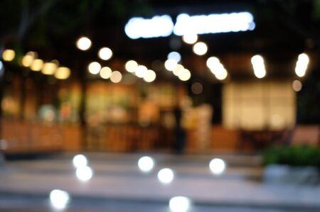 Defocused cafe shop at night